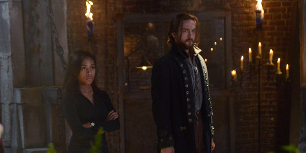 """SLEEPY HOLLOW: Ichabod Crane (Tom Mison, L) and Abbie (Nicole Beharie, R) try to come up with a plan in the """"This is War"""" season two premiere episode of SLEEPY HOLLOW airing Monday, Sept. 22 (9:00-10:00 PM ET/PT) on FOX. ©2014 Fox Broadcasting Co. CR: Brownie Harris/FOX"""