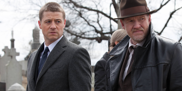 GOTHAM: Detective James Gordon (Ben McKenzie, L) and Detective Harvey Bullock (Donal Logue, R) attend the Waynes' funeral in the Series Premiere of GOTHAM airing Monday, Sept. 22 (8:00-9:00 PM ET/PT) on FOX. ©2014 Fox Broadcasting Co. Cr: Jessica Miglio/FOX